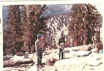 Hugh Provost and Pat Houghton drilling holes for Bill Patton on the way to Siberian Pass. Inyo National Forest, 1972.